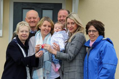 Emma Payne and baby Lily receive the keys to their new home