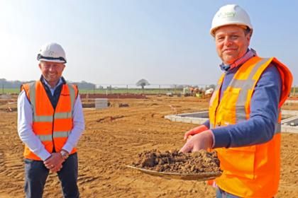 Mark Burghall of Flagship right cuts the first sod at Martham watched by Paul Pitcher of Wellington 500